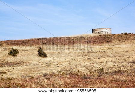 Water Reservoir On Hill In Dry Winter Grass Landscape