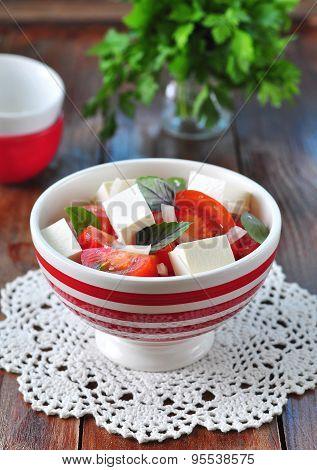 salad of tomatoes, feta cheese, onion and basil