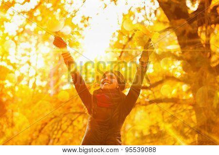 Young woman enjoying nature and sunlight