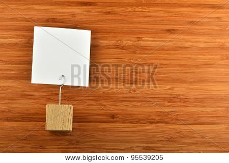 One Paper Note With Holder On Bamboo Wooden Background