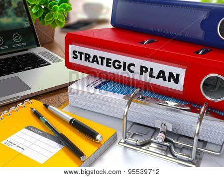 Red Ring Binder with Inscription Strategic Plan.