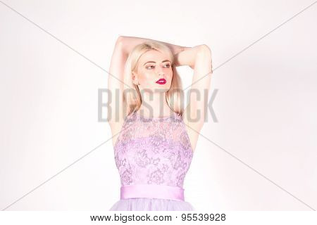 Beautiful woman with blond hair, red lips and hands up. Epilation