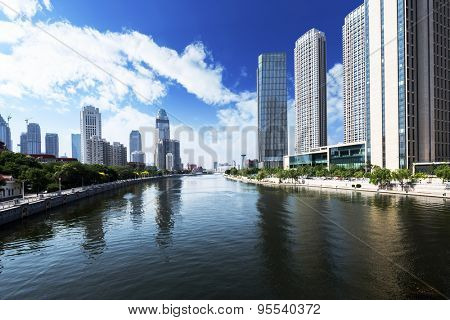 modern buildings in urban city at riverbank