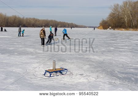 People in the city use frozen river Dnepr for to go in for skating
