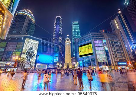CHONGQING, CHINA - JUNE 1, 2014: People stroll through the Jiefangbei CBD pedestrian mall. The district is considered the most prominent financial district in the interior of China.