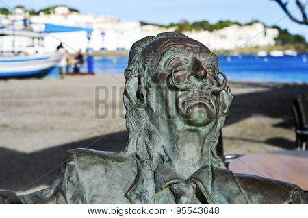 CADAQUES, SPAIN - MAY 20: Detail of a bronze statue of Salvador Dali sitting on a bench on May 20, 2015 in Cadaques, Spain. This little town in the Costa Brava holds the House-Museum of the artist