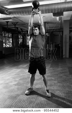 Man In Gym Exercising With Kettle Bell Weight