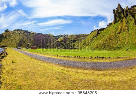 Camping in the canyon Pakgil, Iceland. The canyon -  green grass and moss on fantastic rocks. On canyon there is dirt road. The photo was taken Fisheye lens