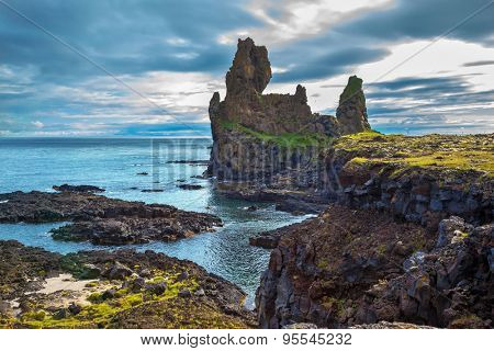 Magnificent Iceland. Northern sea coast. Picturesque ancient Skerries in summer cloudy day