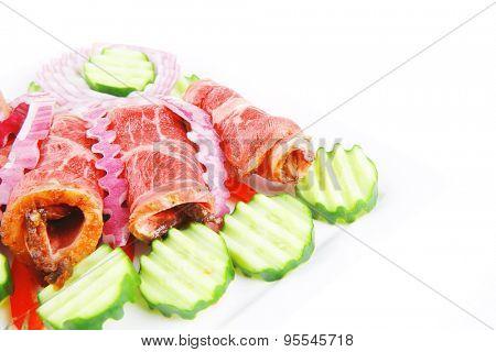 served roasted meat rolls on white platter