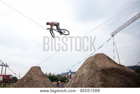 BONTIDA, ROMANIA - JUNE 27, 2015: Unidentified BMX rider making a bike jump during the BMX Competition, at Electric Castle Festival.