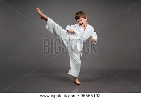 Karate boy in white kimono