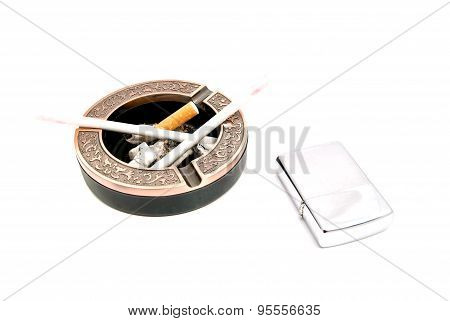Two Ladies Cigarettes In Ashtray And Lighter