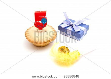 Cupcake With Five Years Birthday Candle, Gift And Whistle On White