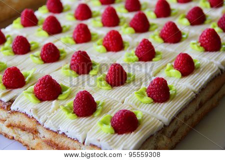 Layered cake with raspberries on top