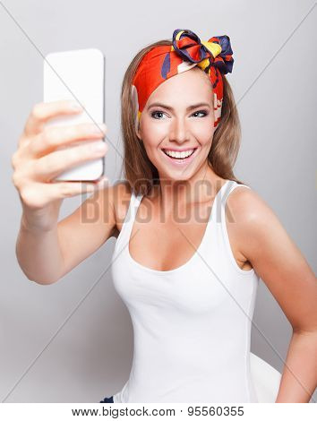 Smiling Pretty Woman Taking A Selfie