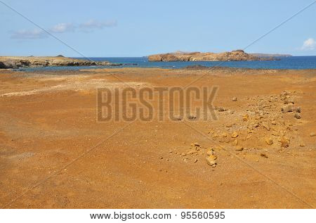Claylike Dry Landscape Over The Clear Waters