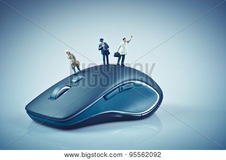 Miniature People On Top Of Computer Mouse. Business Concept