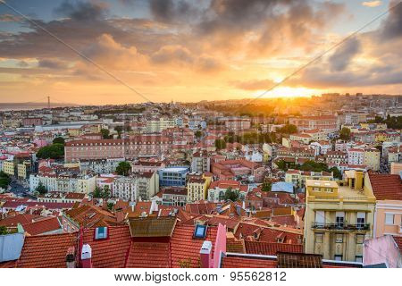 Lisbon, Portugal old town skyline at sunset.