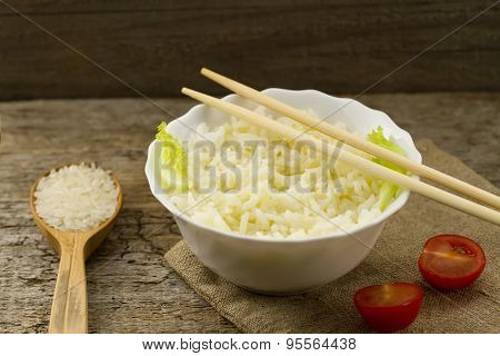 White Plate Of Cooked Long-grain Rice On Wooden Background. Healthy Eating, Diet, Vegetarianism.