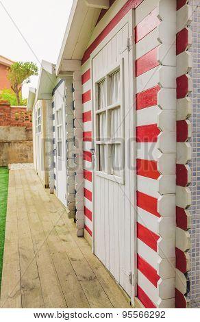 Beach striped huts in a home garden