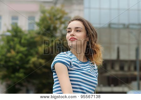 Girl In T-shirt Listening To Music