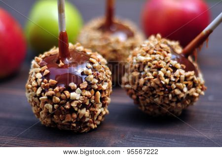 Apples in caramel with peanuts coating closeup