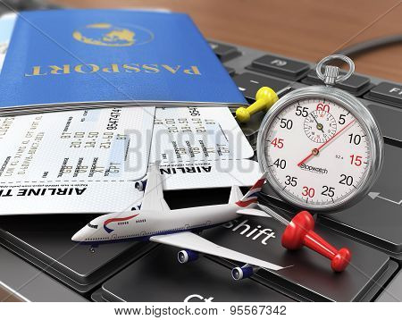 Travel Concept. Passports, Airline Tickets, Stopwatch And Airplane On The Keyboard. Fast Order Air T