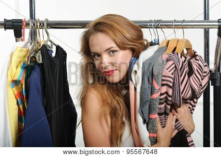 Girl Chooses Things At A Clothing Store