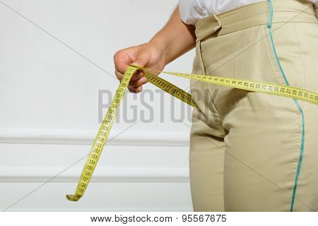 Woman Measuring Her Hips By Tape