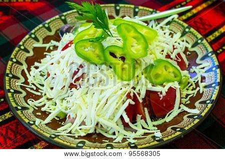 Bulgarian Shopsky Salad made of tomatoes, cucumbers and cheese