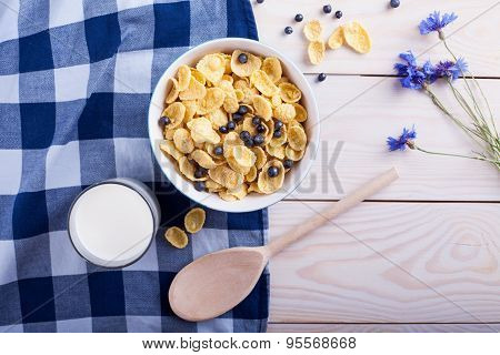 Cornflakes With Bilberry, Milk Cup , Flower And Spoon
