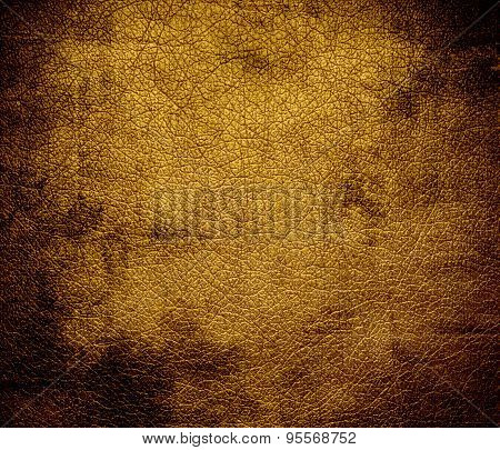 Grunge background of dark goldenrod leather texture