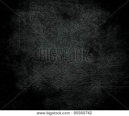 Grunge background of dark jungle green leather texture