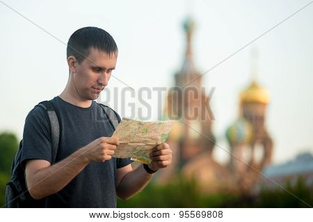Young Traveler Sightseeing With Map