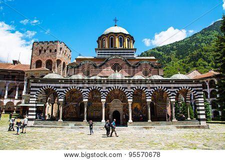 Tourists Near The Church In Famous Rila Monastery, Bulgaria