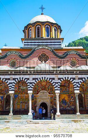 Tourists Near The Church In Rilsky Monastery, Bulgaria