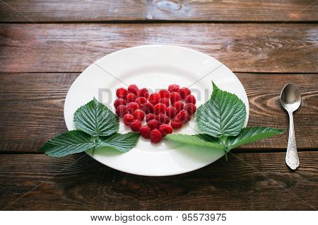 Heart From Raspberry On A White Plate