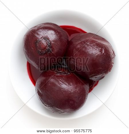 Three Whole Cooked Beetroots In White Dish Isolated From Above.