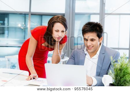 Two young business collegue working together in office
