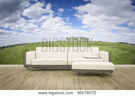 3D rendering of a sofa in front of a photo wall mural stonehenge