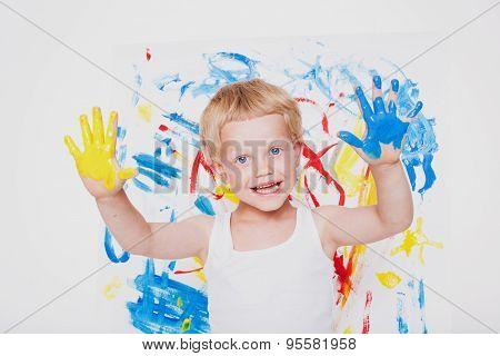 Portrait of a little messy kid painter. School. Preschool. Education. Creativity. Studio portrait