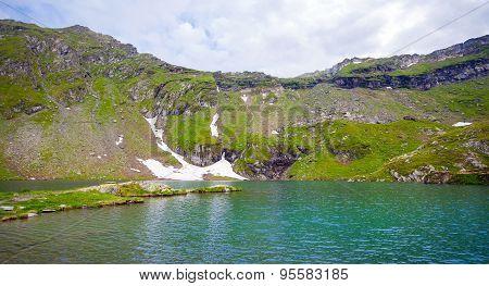 Idyllic View Of Balea Lake Shore In Fagaras Mountains