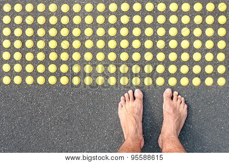 Naked Human Barefoot On Asphalt Road At Tactile Bumps Paving - Life Concept Of Human Feelings