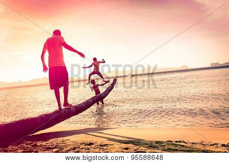 Father Playing With Sons At Tropical Beach With Tilted Horizon - Concept Of Family Union