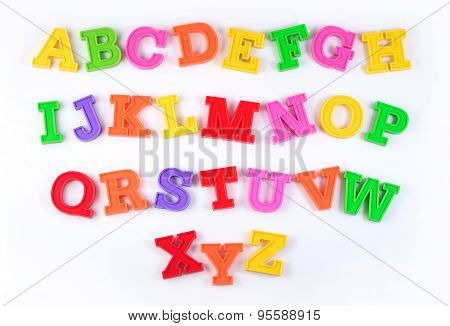 Colorful Plastic Alphabet Letters On A White