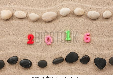 New Year 2016 Written On The Sand Among Stones