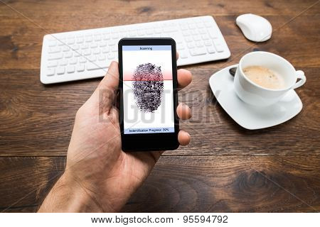 Person Hands Holding Mobile Phone With Fingerprint Application