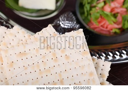 Matzo for Passover with Seder meal on plate on table close up