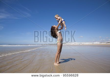Baby Flying In Woman Arms Next To Conil